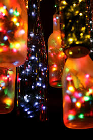 an outdoor chandelier made out of wine and beer bottles. I'd make a Christmas  light strand into beer outdoor lights