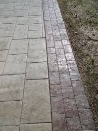 your property s natural beauty with custom colored stamped concrete choose garrett concrete and retaining walls for your next custom concrete project