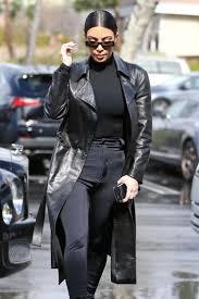 kim kardashian leather black trench coat figure hugging black sweater black boots