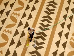 how not to write a travel essay about hawaii the atlantic a worker cleans off a rooftop deck at a hotel in waikiki in 2016 kevin lamarque reuters