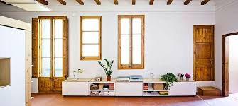 View in gallery Refurbished living space of small, modern apartment in  Barcelona