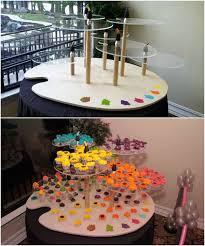 rainbow bat mitzvah cupcake display art palette artist paintbrush stand cupcakes theme decor