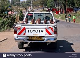 Smiling children riding in the back of pickup truck at Nairobi Stock ...