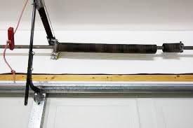garage door shaftIf a garage door spring breaks should you replace both of them