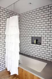 modern bathroom subway tile. Via Design*Sponge Modern Bathroom Subway Tile O