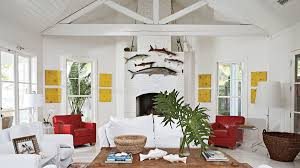 Rooms with white furniture Girly Bedroom School Of Fish Are Hung Above White Painted Fireplace While Red Leather Chairs Flank Interior Design Ideas 48 Beautiful Beachy Living Rooms Coastal Living