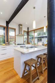 melbourne under cabinet lighting with stainless steel wall mount range hoods kitchen midcentury and wood ceiling