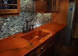 you can jazz up your copper countertop with insets of small tiles at the corners of the sink as they have done above