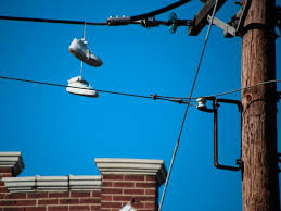 this powerful essay about a painful childhood memory got a student  sneakers on telephone wire