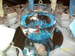 Goldfish centerpiece on mirror with blue rocks! YES.