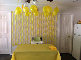 party cake table decor yellow streamers duck sunshine wall decoration with paper ribbons party cake table