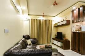 classic design living room. two bhk - whitefield: classic living room by wenzelsmith interior design pvt ltd
