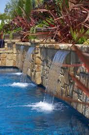 Swimming pool water feature with stacked stone columns and fire pots. -  www.lonestaraz.com | Peaceful Water Features | Pinterest | Swimming pool  water, ...
