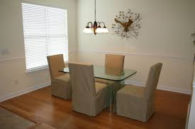 formal dining with beautiful banboo flooring crown and chair rail molding