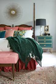 I love this Emerald and raspberry pink master bedroom design but especially  how the deeper pink valance really brings in the warmth and luxury.