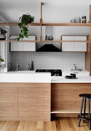 wooden kitchen cabinets are made more modern with white countertops and cabinet doors