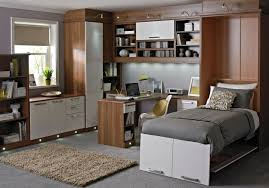 inspiring design ideas of cute home office with mounted white brown wooden table with shelves also cabinet home office design