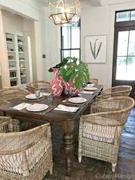 beautiful coastal dining room with dark wood floors and lots of whicker accents and furnishings dark
