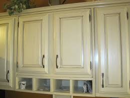 painting and refinishing wall mounted oak kitchen cabinet with white color ideas