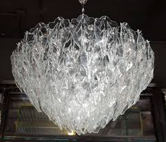 ont murano glass chandelier featuring numerous tiers of hand blown murano glass leaves that individually hang