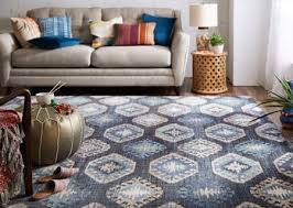 when using a smaller area rug place the front legs of the furniture on the rug and use furniture coasters under the back furniture legs to achieve level