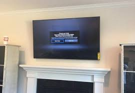 Tv mount for 65 inch tv Lcd 65 Inch Flat Screen 4k Tv Mounted On Fireplace By Carolina Custom Mounts In Charlotte Nc Carolina Custom Mounts Tv Over Fireplace Mounting And Installation Services Charlotte Nc