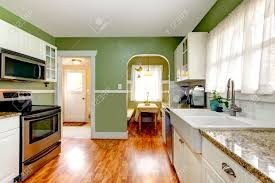 Open Floor Kitchen Bright Kitchen Room With Green Wall And Hardwood Floor Kitchen