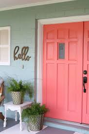 Cheery coral painted front doors