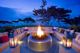 outdoor living spaces gallery  living room outdoor living room with sofa and fireplace and candle and cushion and plant