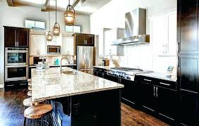 kitchen dark cabinets light granite dark cabinets with granite kitchen with dark cabinets and off white painted walls and white upper dark kitchen cabinets