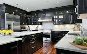 black cabinets white countertops elegant kitchen featuring black cabinets with white and stainless steel appliances dark black cabinets white countertops