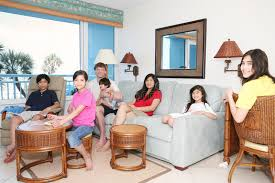Download Family Relaxing In Living Room Stock Image - Image of mother,  rattan: 9573915