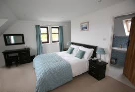 picture showing the king size bed in the master bedroom of croft cottage there