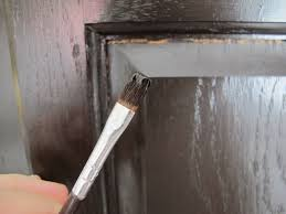 gel stain kitchen cabinets: cracks in the stain on the doors caused by natural expansion and contraction of the oak