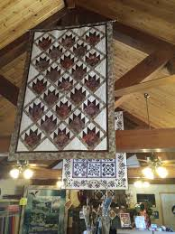 Bear and Moose News & Yes, those Quilts should look familiar! Belinda has a Trunk show from us  beautifully displayed in this awesome Quilt shop. Love the rafters. Adamdwight.com
