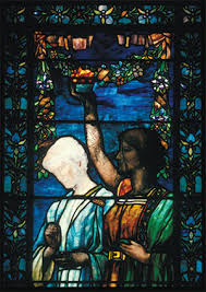 detail of a stained glass window depicting two figures the painted face of the figure