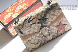 gucci 403348. it comes with: serial and model numbers,the gucci dust bag,care booklet, cards 403348