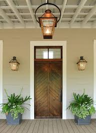copper framed glass covered gas lamps with round link