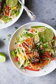 easy teriyaki salmon served on a bed of asian noodles made with brown rice noodles