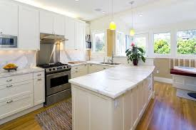 corrugated metal backsplash kitchen contemporary with suspended curved panel stainless steel gas and electric ranges