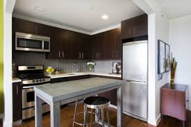 contemporary kitchen office nyc. The Contemporary Apartment Features A Sleek Layout With Modern Open Kitchen, High Ceilings, And Wall Of Windows. Kitchen Office Nyc O