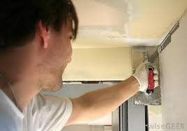 spackling or joint compound is applied over the drywall patch to achieve a smooth finish