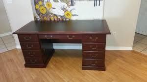 heritage hill double pedestal desk that he got from office depot officedepot com a s 576868 sauder heritage hill double pedestal desk