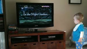 kids watching tv at night. warning to cut tv for young children. watching in the night kids tv at