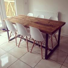 here is our 6 8 seater dining table made from reclaimed timber and steel the top is made from solid 2 1 2 thick timber the grain and look of the