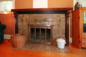 you can use smaller tiles in the same color family for a variegated look or larger tiles of the same color for a sleek modern look tile fireplace