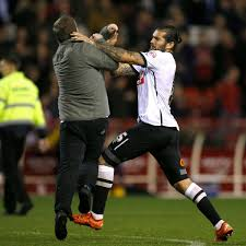 Derby County's Bradley Johnson appears to clash with pitch invader after  Nottingham Forest loss - Irish Mirror Online