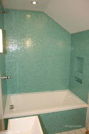 glass mosaic tiles installation on bathtub surround