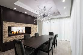 magnificent maria theresa 6 light crystal chandelier dining room contemporary with gas fireplace chairs swag curtains