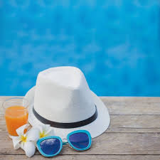 swimming pool background. Hat, Sunglasses And Drink With Swimming Pool Background Free Photo